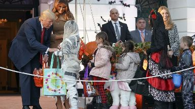 Carefully selected trick-or-treaters collected sweets from the President and First Lady.
