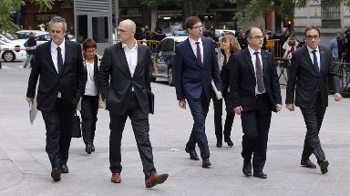 Former Catalan Cabinet members arrive at the national court in Madrid.