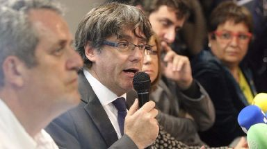 Carles Puigdemont has said he is not seeking political asylum in Brussels.