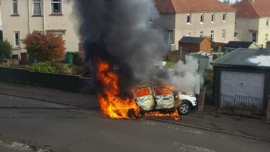 Kirkcaldy: Car in flames after blast.