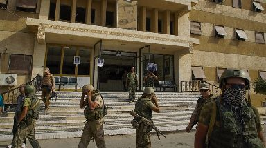 Russian military police soldiers walk outside a hospital in Deir ez-Zor.