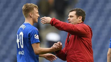 Ross McCrorie is congratulated by Graeme Murty.