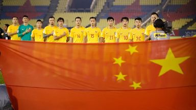 China's football team stand ahead of a World Cup qualifier match.