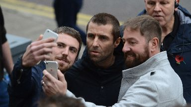 Oasis: Fans rushed to meet the singer.