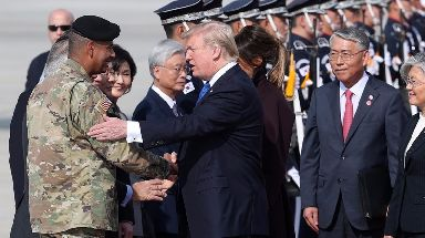 President Donald Trump shakes hands with Gen. Vincent Brooks, commander of United States Forces Korea.