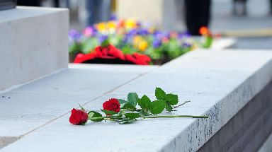 Roses lie at the Cenotaph in Enniskillen, in memory of the bomb victims.