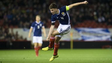 Stand-in Scotland skipper Kieran Tierney shoots from range against Holland.
