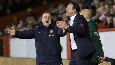 Holland boss Dick Advocaat (left) and Scotland manager Malky Mackay on the touchline.