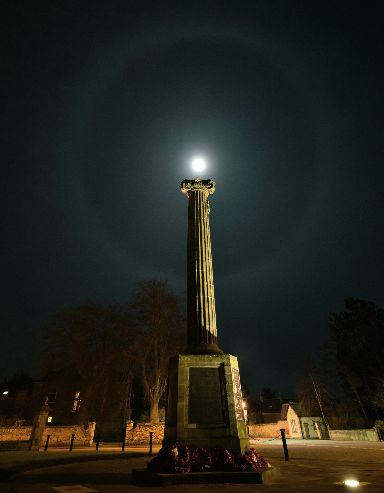 A moonbow appears over Nairn's war memorial.