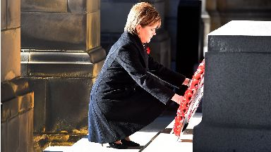 Remembrance: First Minister Nicola Sturgeon lays a wreath in Edinburgh.