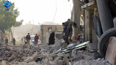 Residents inspect the rubble in the aftermath of the attack.