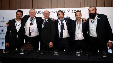 French Rugby Federation president Bernard Laporte (centre left) after surprise announcement in London.
