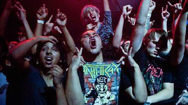 Life thru a lens: Sandy Carson captures the raw emotion of a crowd.