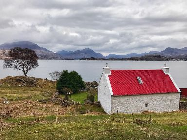 Red roofed cottage by Loch Torridon.