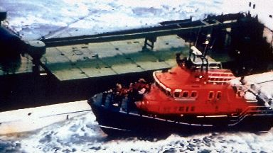 Rescue attempt: Lifeboat alongside the Green Lily.
