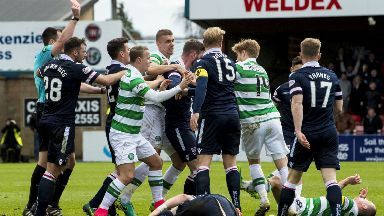Ross County and Celtic players clash following Scott Brown's red card.