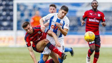 Dundee's Cammy Kerr challenges Kilmarnock winger Jordan Jones.