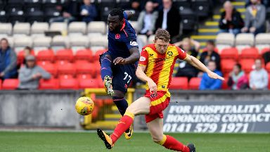 Isma Goncalves is challenged by Partick Thistle defender Niall Keown.