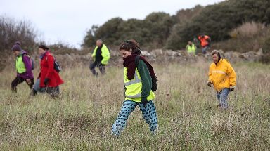 Volunteers scour a search area near to Swanage.