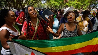 Zimbabweans gather to pray for the country in a park opposite the parliament building in Harare.