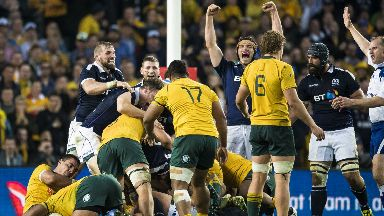 Scotland players celebrate after winning a penalty in the dying moments of their 24-19 victory.
