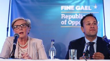Frances Fitzgerald (left) is facing calls to quit over what Leo Varadkar called a 'trumped up charge'