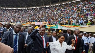 Emmerson Mnangagwa and his wife Auxillia arrive at the stadium.