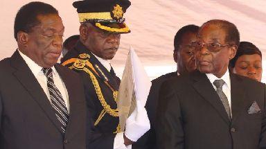 Emmerson Mnangagwa (left) and Robert Mugabe at a gathering in early November