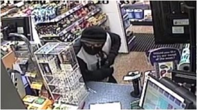 Garage: Police want to speak to man in image.