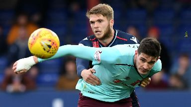 Hearts forward Kyle Lafferty and Ross County defender Marcus Fraser vie for possession.