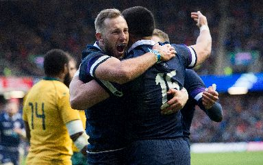 Ranpant: Byron McGuigan (left) celebrates his try with Sean Maitland