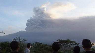 Local villagers watch on as Mount Agung erupts.