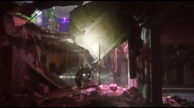 Firefighters work amongst the rubble of the nightclub.