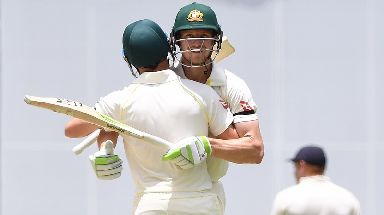 Australian batsmen David Warner (right) and Cameron Bancroft celebrate after Australia won on Day 5 of the First Test match between Australia and England at the Gabba in Brisbane.