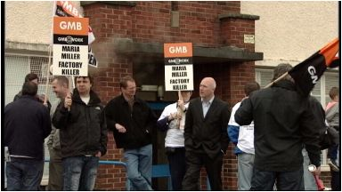 Protests: Workers campaigned outside factories in 2013.