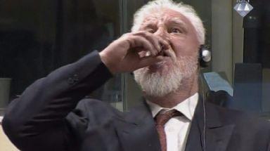 Slobodan Praljak drinks the 'poison'.