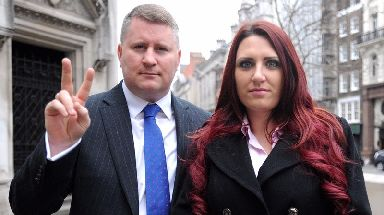 Paul Golding, leader of Britain First, and the party's deputy leader, Jayda Fransen, arrive at the Royal Courts of Justice in central London.