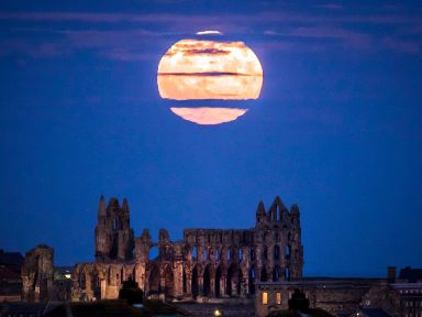 The moon rises over Whitby Abbey in Yorkshire