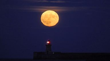 Moon over the lighthouse in South Shields