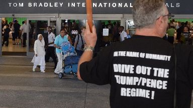 Demonstrators greet travelers arriving at Los Angeles International Airport.