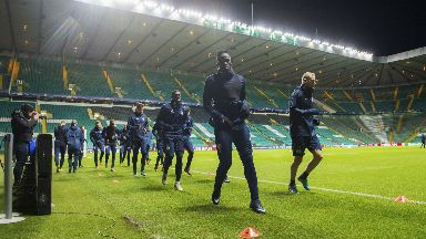 Anderlecht players train under the Celtic Park lights.