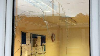 Damage: Five windows were smashed.