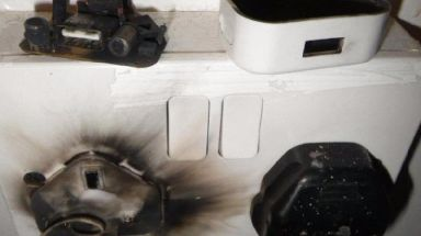 A socket that was scorched during the charger safety tests
