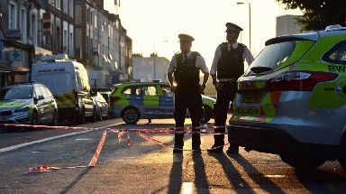 Police guard a cordon in Finsbury Park, London, after a van hit pedestrians.