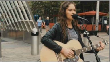 Star in the making: Natasha was busking in Glasgow when she was spotted.