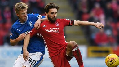 Graeme Shinnie: The skipper vies for possession in the 2-1 loss to Rangers.