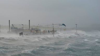 Winds: Storm-hit Gill Pier in Westray, Orkney.