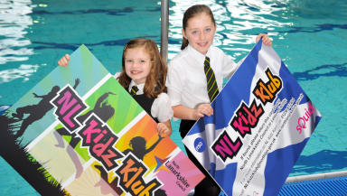Dive in: Grace Carr and Joanne Hamilton promote the card at Wishaw Sports Centre