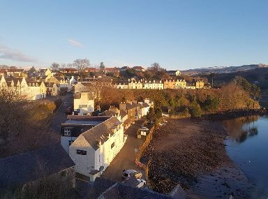 A sunlit Portree in the morning.