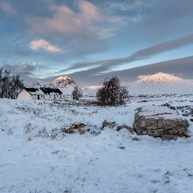 Black Rock Cottage and Stob Dearg dusted in snow near Glencoe.